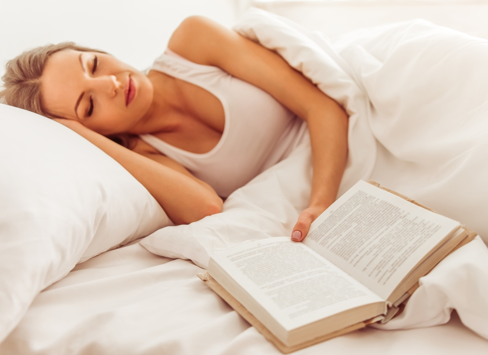Woman sleeping with book