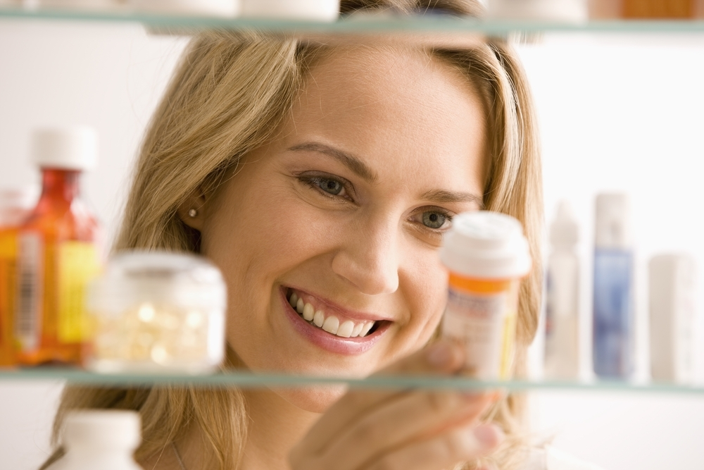 Woman at medicine cabinet