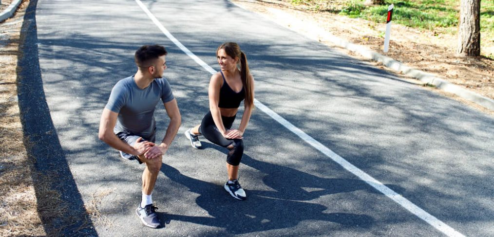 couple doing walking lunges