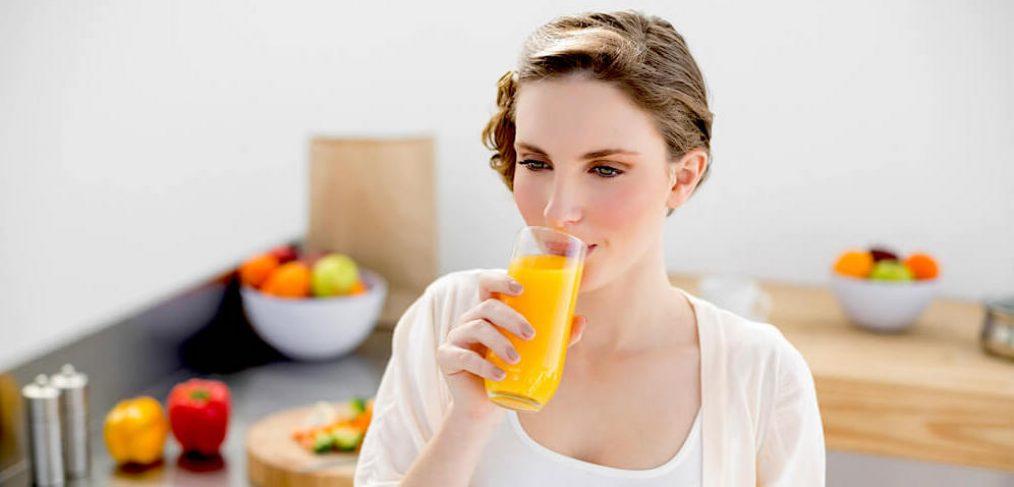 woman drinking OJ