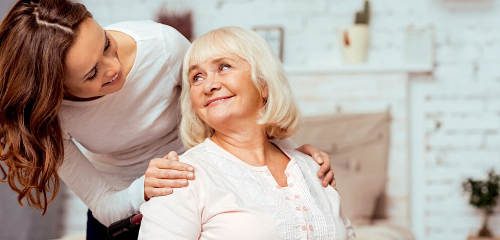 Senior woman smiling at her caregiver