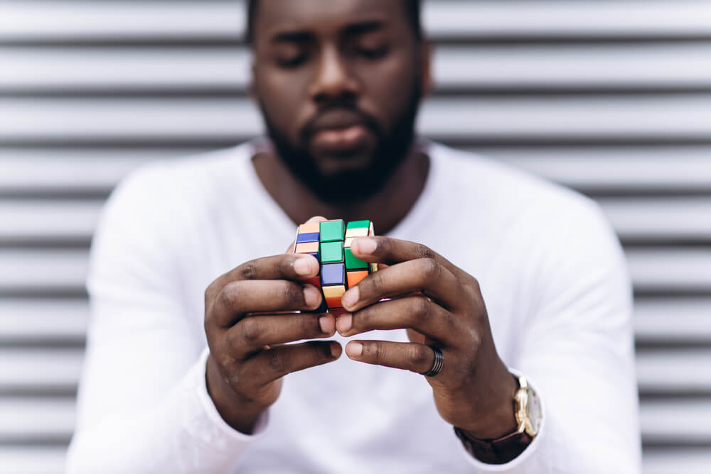 man playing with rubik's cube