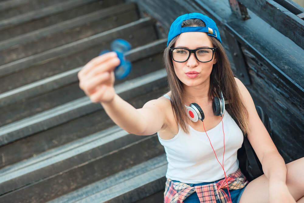 woman holding fidget spinner