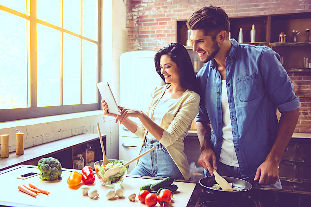 couple prepping food in the kitchen