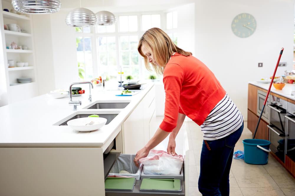 woman decluttering her environment