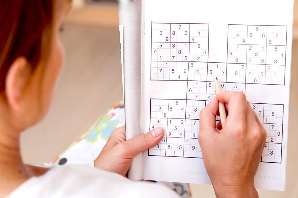 woman playing sudoku