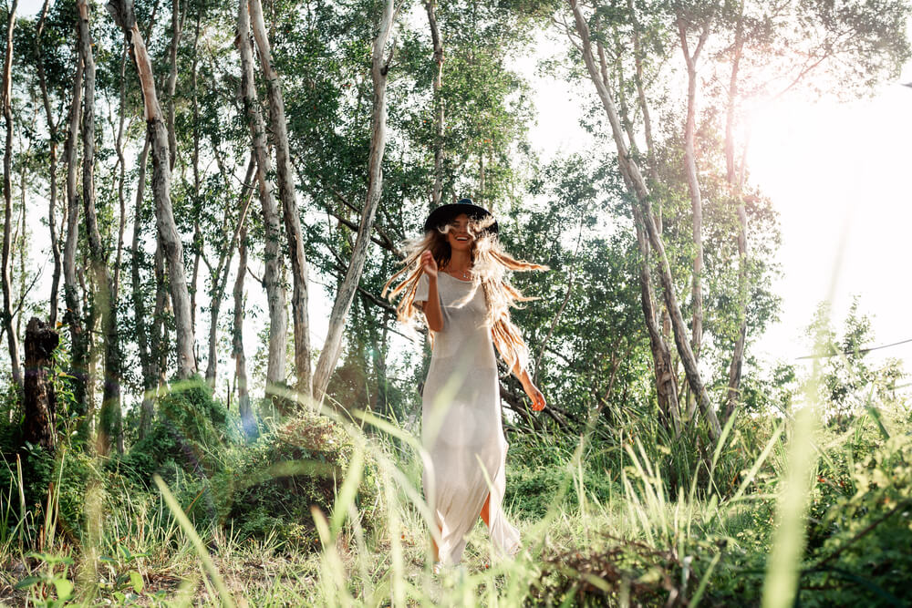 happy woman walking in the forest