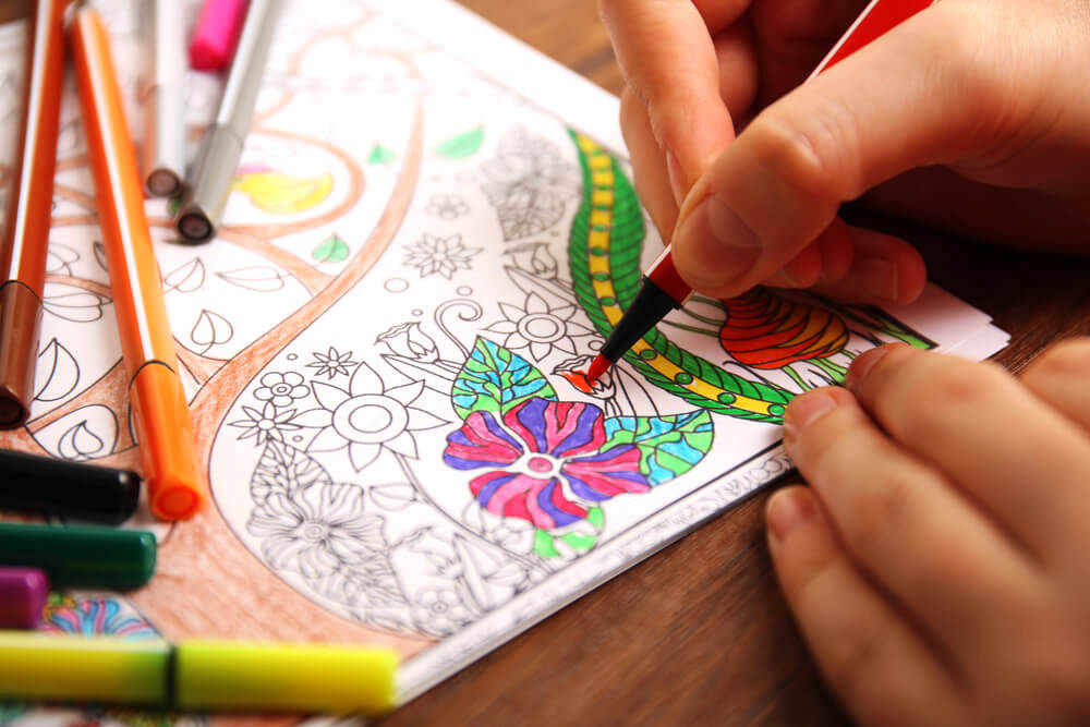 Coloring in coloring book using colored pens