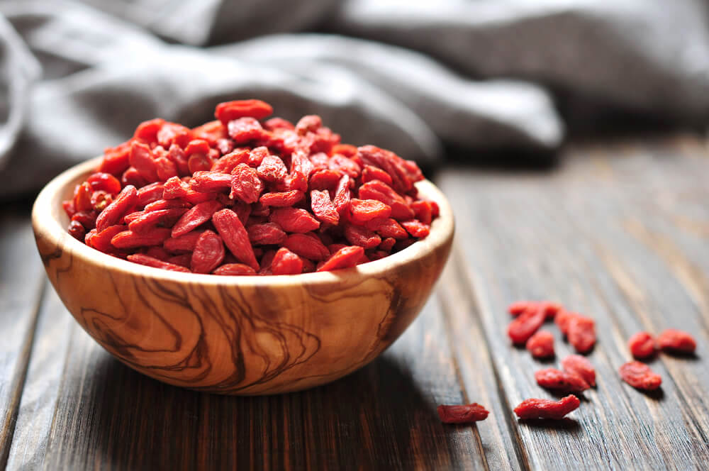 A bowl of fresh goji berries