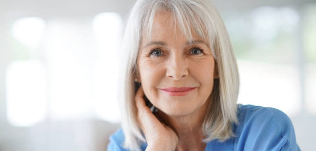 Portrait of smiling mature woman with white hair