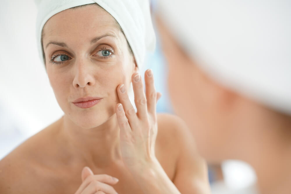 woman applying primer or moisturizer