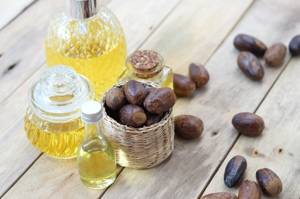 Nutmeg oil surrounded by loose nutmeg