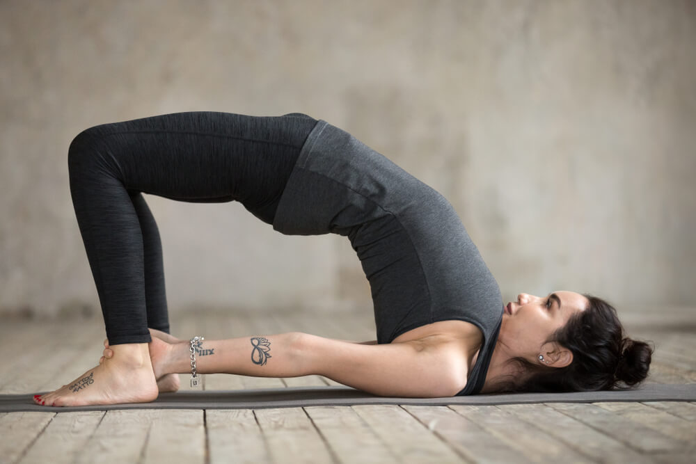Woman doing the bridge pose