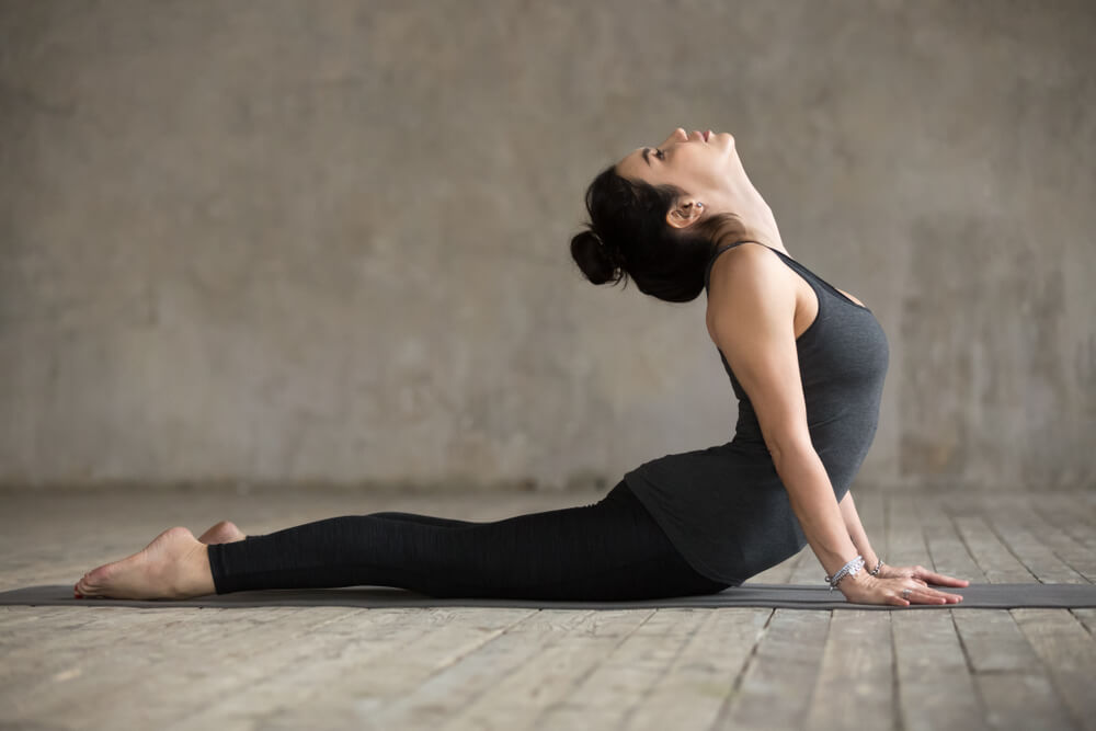 Athletic woman in cobra pose