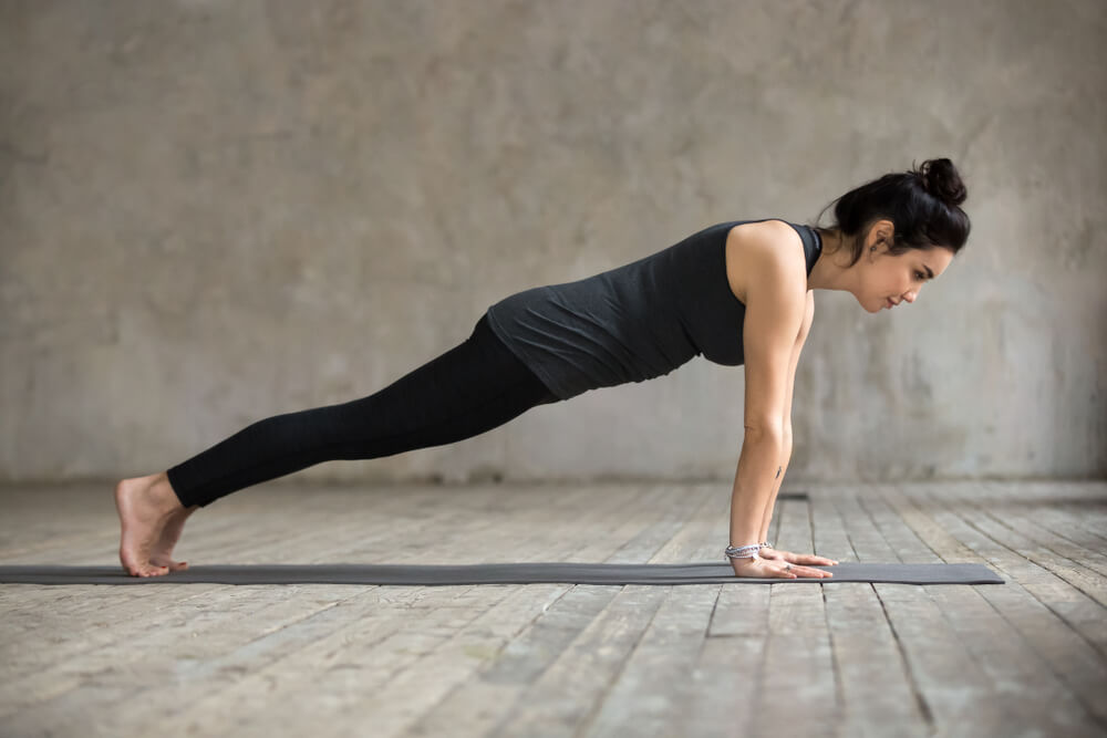 Athletic woman in plank position