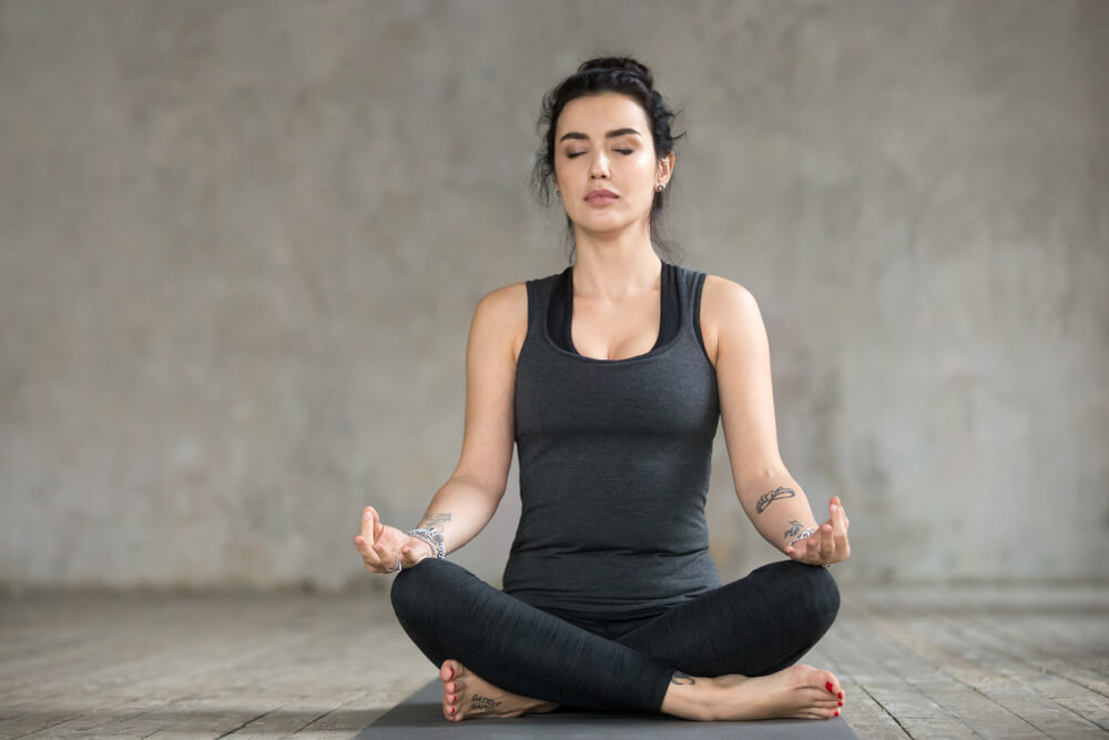Calm woman in sukhasana pose