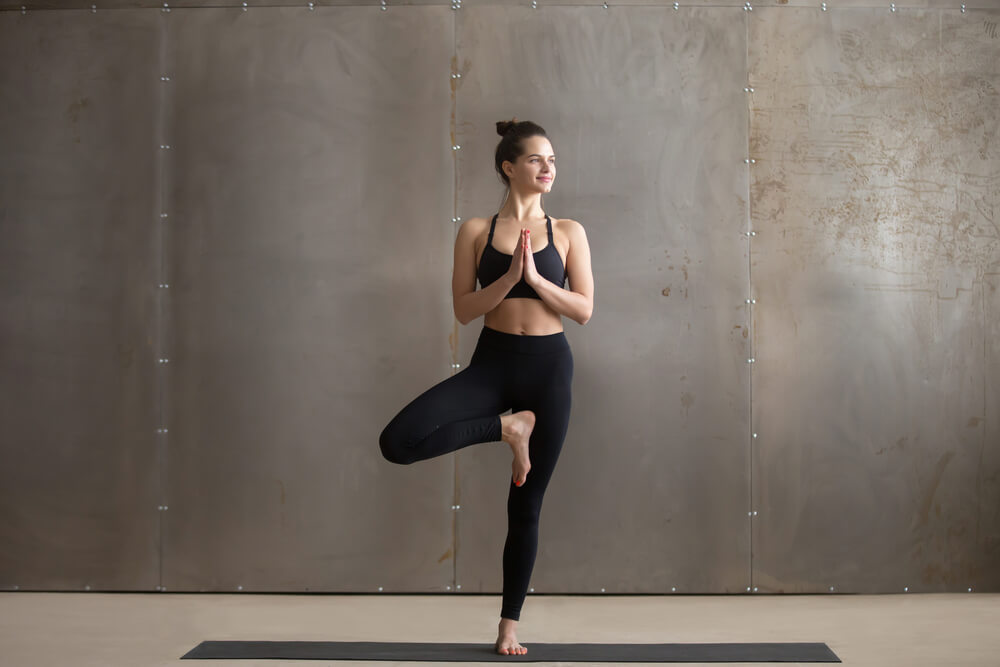 Woman in yoga tree pose